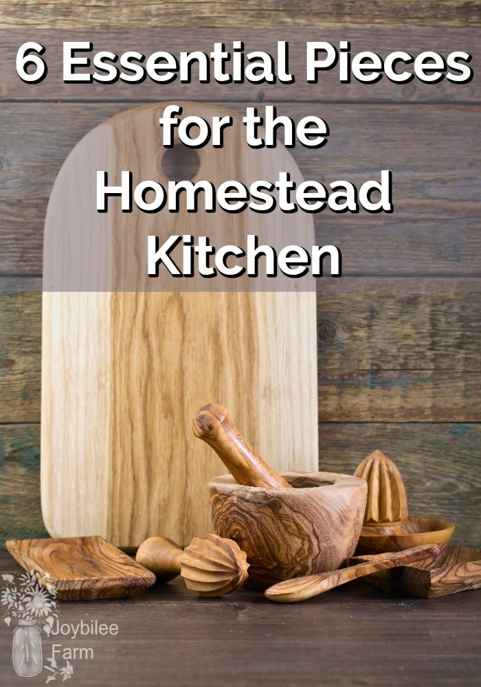 Picture of wooden cutting board and kitchen tools