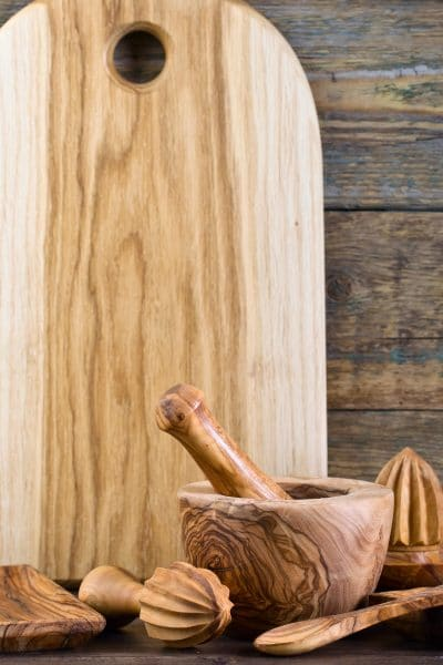 Picture of wooden cutting board and kitchen utensils