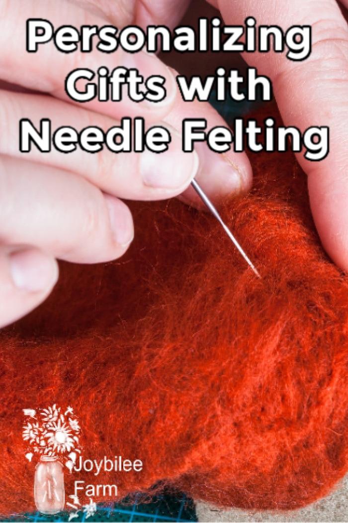 hands needle felting on reddish wool
