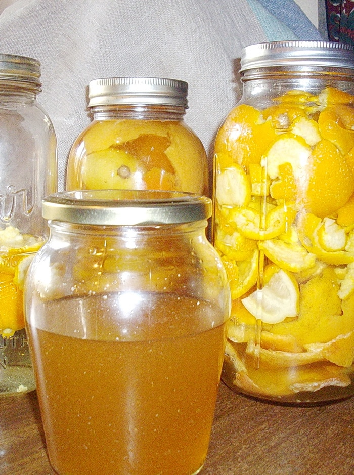 citrus cleaner in a jar and jars with citrus peels