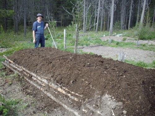The final layer is finished compost. Your hugelkultur bed is ready to plant immediately.