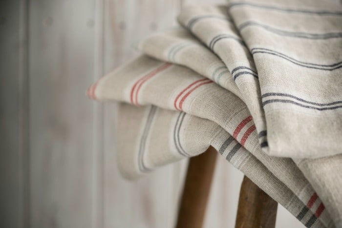 Vintage linen is a rare and beautiful textile that has no peer in modern fabric. It is worth taking the time to seek it out in antique shops, thrift shops, and garage sales. Vintage linen fabrics hold a softness and lustre that can't be imitated and radiate quality and comfort when used in your home.