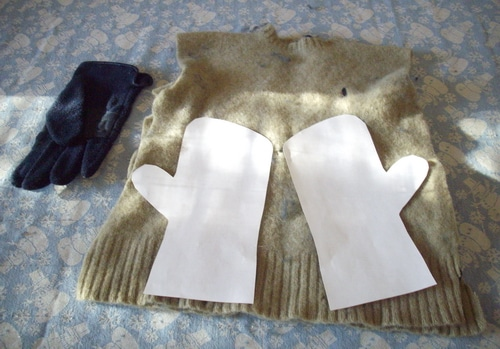 Mittens laying out pattern on sweater