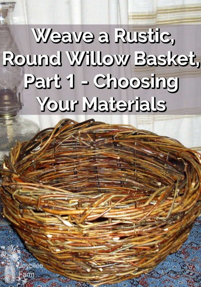 Hand woven willow basket sitting on a table beside an oil lamp