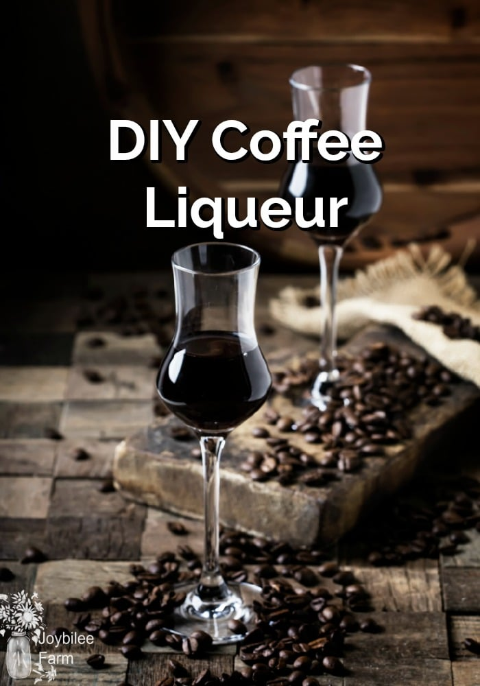 Two flutes of coffee liqueur with coffee beans scattered around