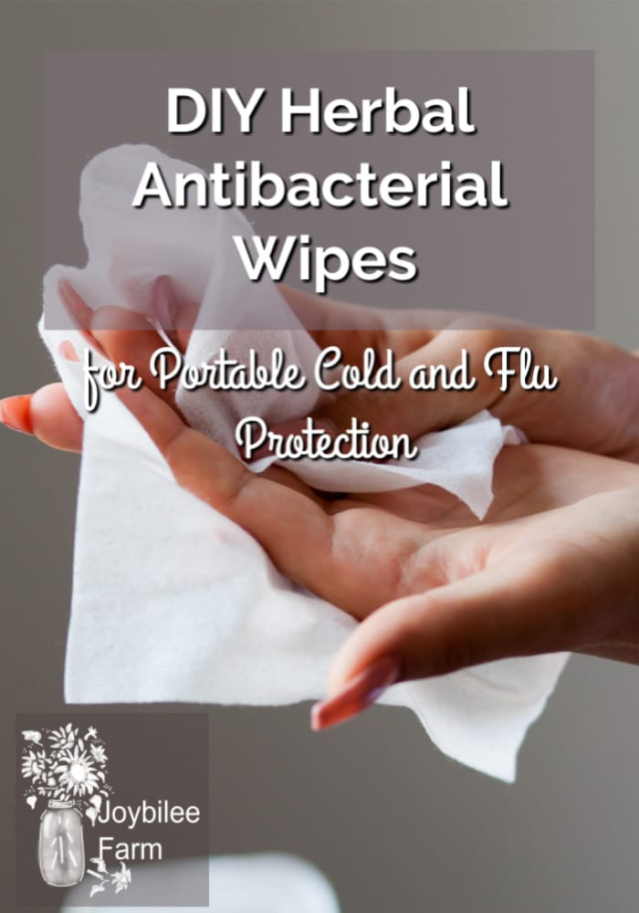 DIY antibacterial wipes being used on a woman's hands