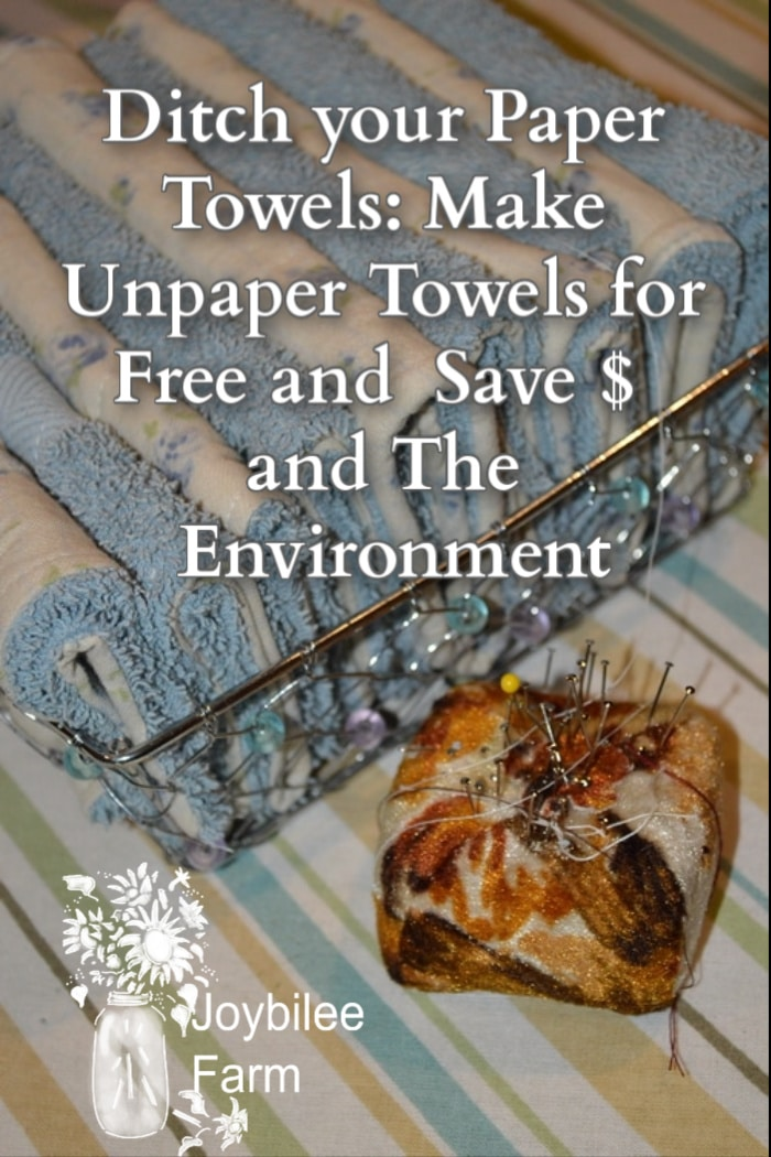 freshly sewn unpaper towels in a reusable basket with a pin cushion in front