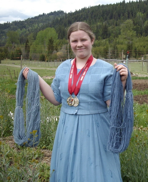 Sarah with yarn dyed with woad and her medals received for winning 2 consecutive years at the Canadian science fair