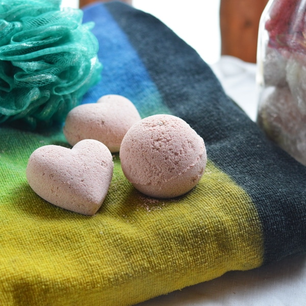 Bath bombs are a fizzy parcel of hydrotherapy in a joyful single serving portion. The dry bath bomb enters the bath tub and immediately erupts in fizzy, foaming delight that is reminiscent of the volcano demonstrations at grade one science fairs. However, the bath bomb is even more wonderful because it explodes with fragrance and herbal goodness, moving a mundane bath into the realm of therapeutic delight. But even though they are wonderful, soothing, and fragrant, the technique necessary to make them at home is difficult to master.
