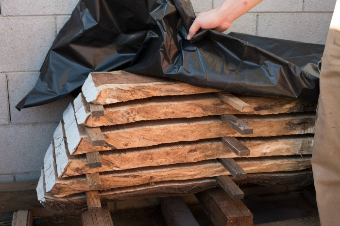 When a tree falls in an urban area a DIYer will mill it and then dry it using these best practices to season lumber from downed trees.