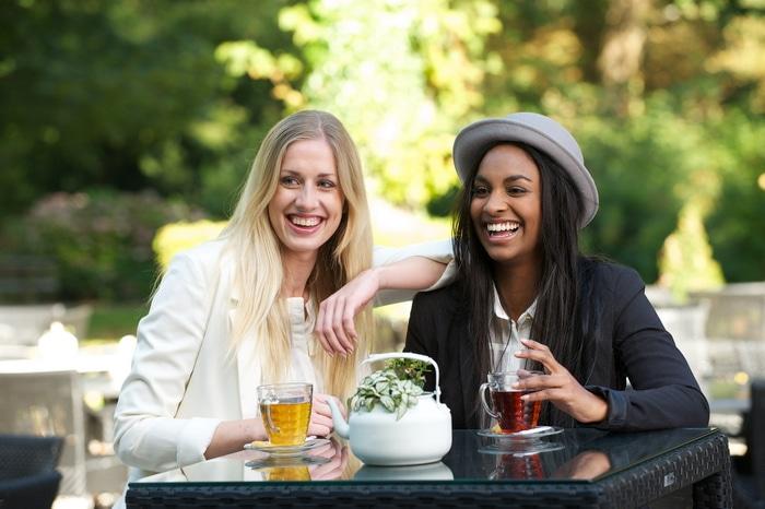 Two women drinking tea.