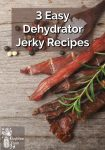 Jerky slices by peppercorns, a sprig of fresh herbs and a spoonful of salt