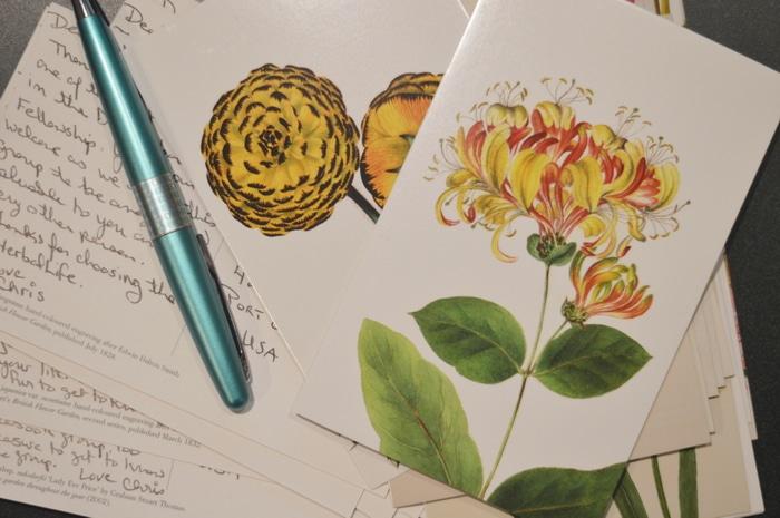 handwritten notes on postcards