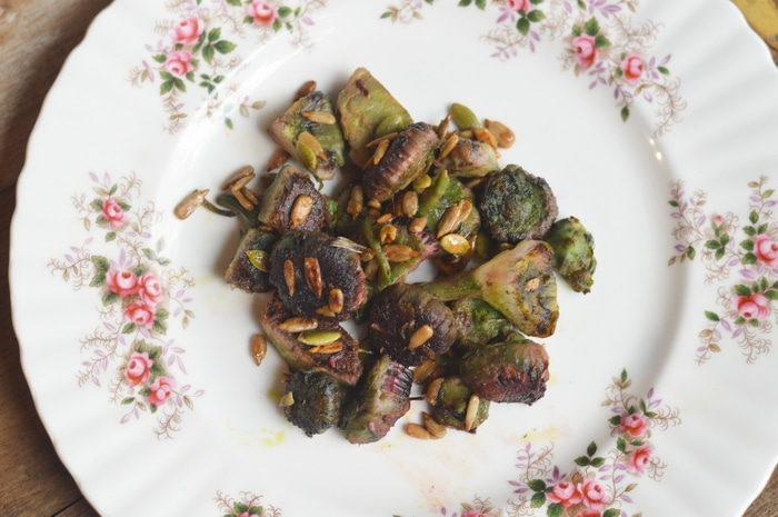 Sunflower buds sauted in butter and garlic and marinaded in fresh lemon juice.