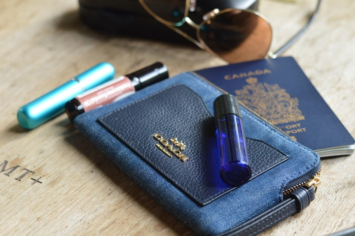 purse and rollerball with essential oils and other travel related items