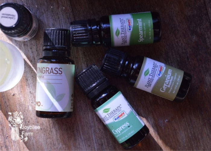 essential oils in bottles with spray bottle make natural tick repellent