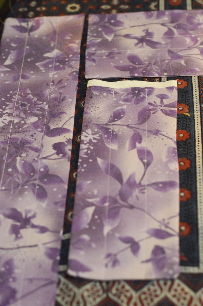 purple fabric with sewn channels for adding flaxseed
