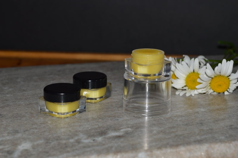 homemade solid perfume in plastic containers