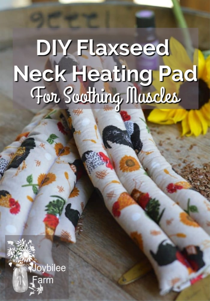 2 homemade neck heating pads on a table with flowers