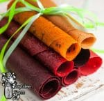 fruit leather rolled up and tied with a green ribbon