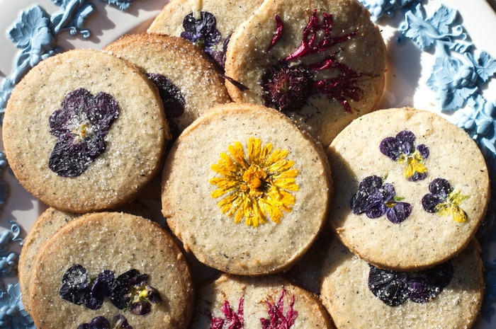 gluten free edible flower cookies on a tray