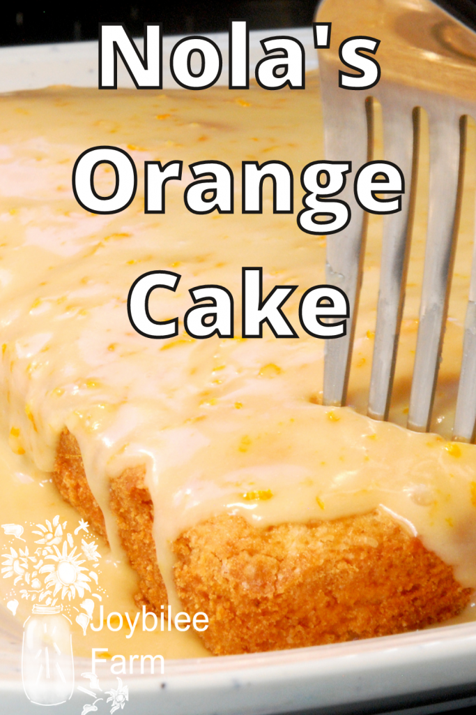 tasty orange cake, with a fork in it to take a bite